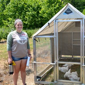 Student with portable chicken coop.