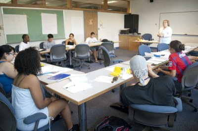 Associate Professor of Communication Pat McFarlane leads an Oral Communication class.