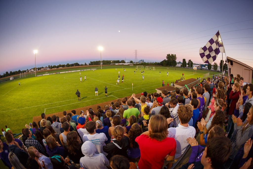 Collegiate athletic at Goshen include soccer teams, shown here being supported by other students