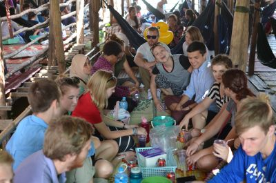 The group having a fabulous lunch on a bamboo hut over a pond.