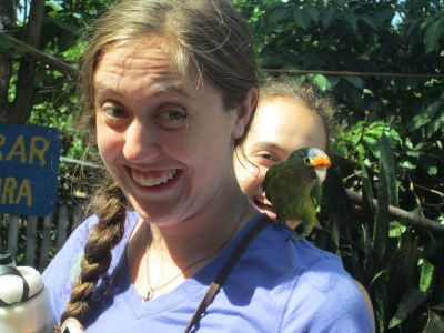 Emily and Molly (and several others) make a new friend on the Vicente Padilla coffee farm.