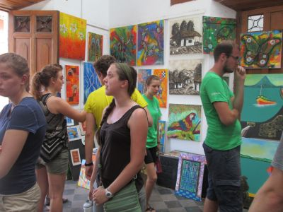 Emily S. and others admiring the colorful and creative artwork of local artists.