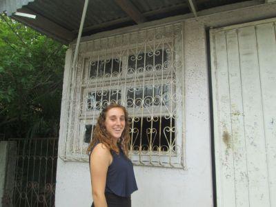 Maddie outside her host family home in Esteli