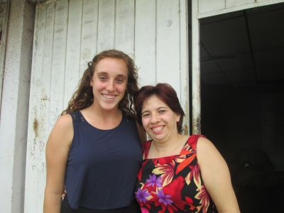 Maddie with her service host mom, Fatima, outside their home.