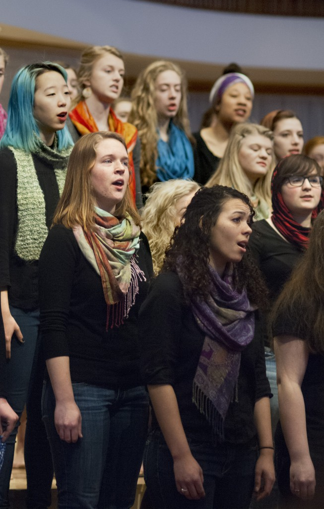 The Goshen College Women's World Music Choir  toured in Pennsylvania during their Spring Break. During performances, members wear vibrantly colored scarves and go barefoot as a way to feel connected to the earth and to women around the globe. (Photo by Brian Yoder Schlabach)