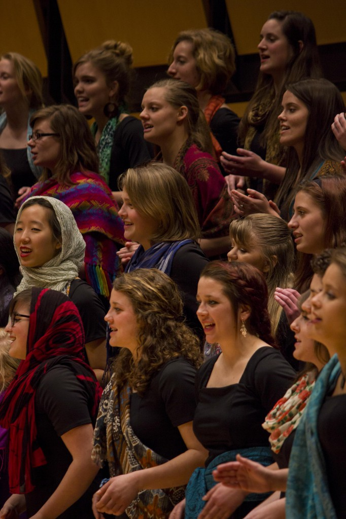 The Goshen College Women's World Music Choir recently celebrated their 10-year anniversary with a February concert.  During performances, members wear vibrantly colored scarves and go barefoot as a way to feel connected to the earth and to women around the globe. (Photo by Hannah Sauder)