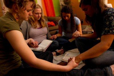Students praying during bible study