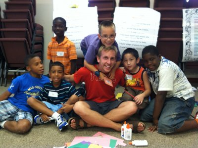 Quinn with children while on Mission Inquiry