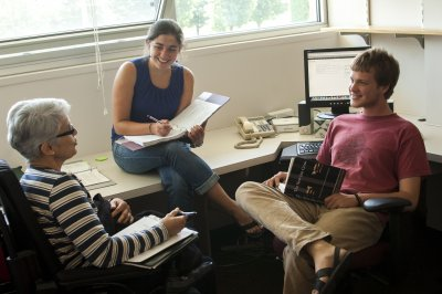 Students collaborating with Conflict Transformation Studies professor during Maple Scholars summer research program
