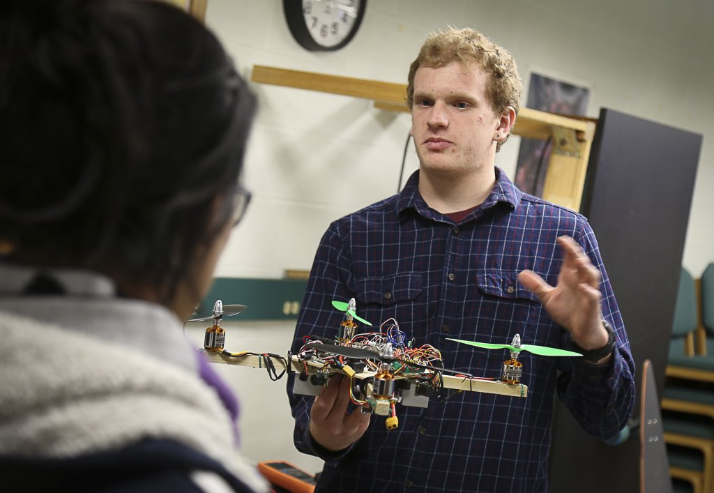 Goshen College physics student presents on wall-avoiding quad-copter at bi-annual Electronics Show