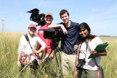 Four people and video equipment