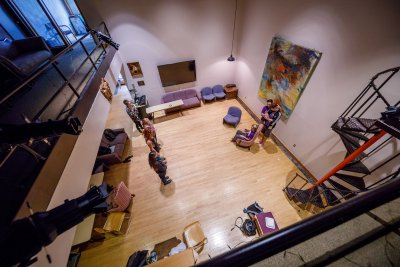 Aerial shot of theater students practicing in a backroom