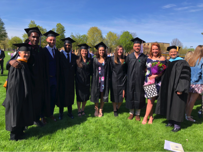 Graduating Kinesiology students posing with a professor