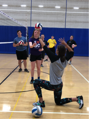 Students practicing volleyball in the Rec-Fitness Center