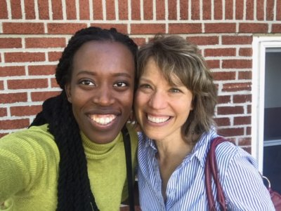 Two women standing next to each other smiling