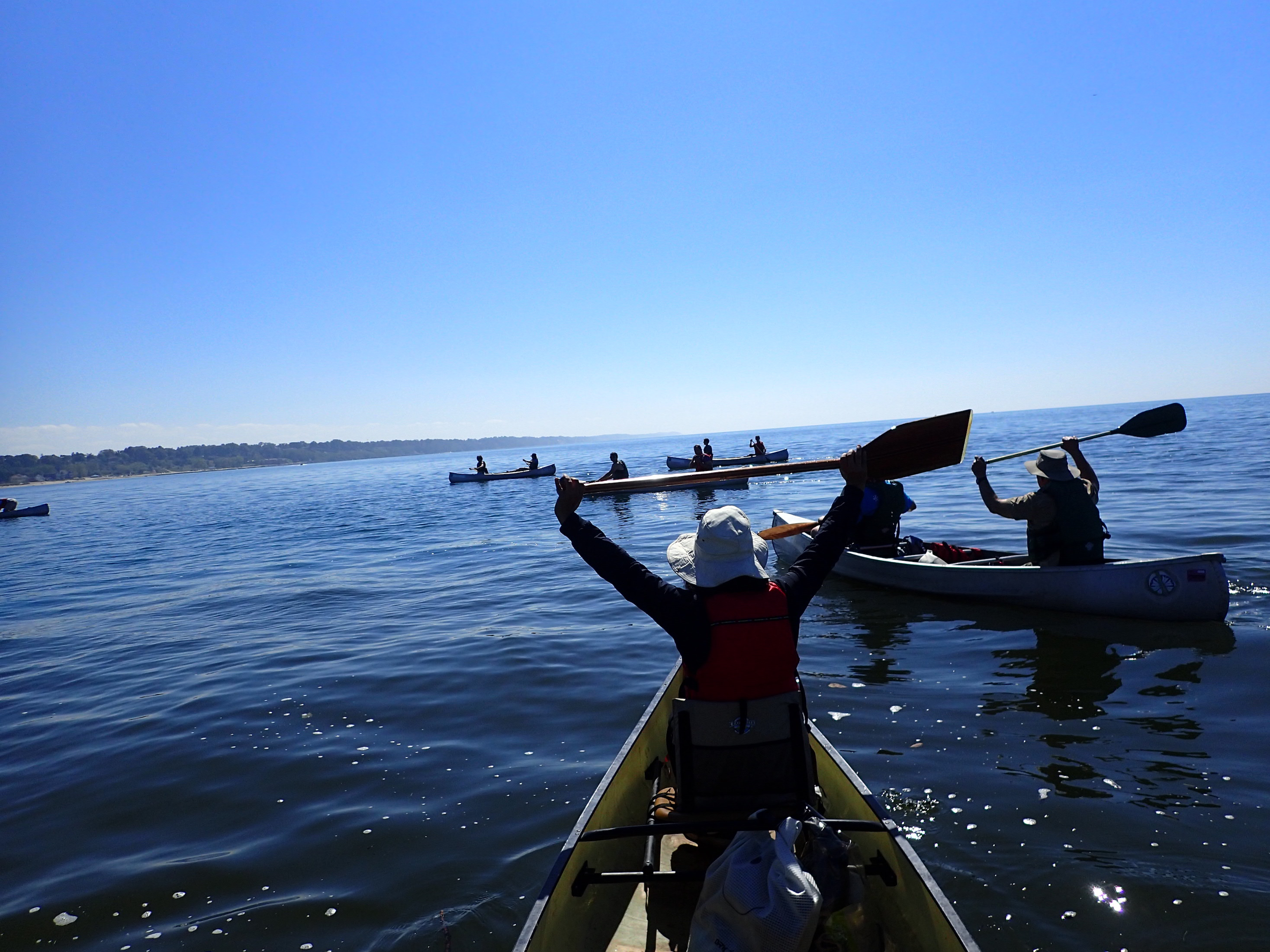 Students canoeing on a lake