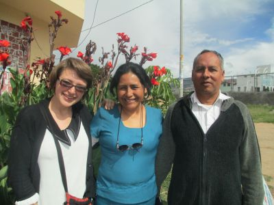 With her host mother, Raquel, and father, Max