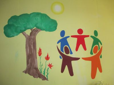 She was given an assignment that suits her well:  paint the figures on this and several other classroom walls