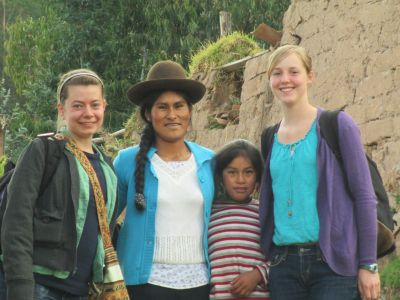 With their host mother, Yovana, and sister