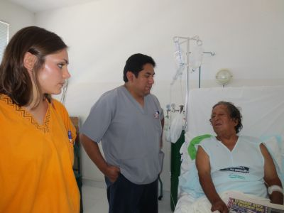 Examining a patient who suffered a stroke while working on his farm