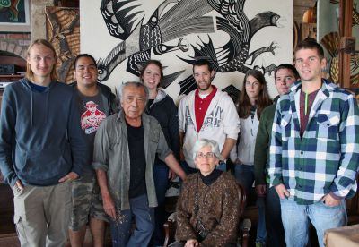 Victor Delfin poses in his studio with GC students Landon, Jacob, Becca, Rudy, Lauren, Joshua and Alan with Peru SST co-leader Judy Weaver.