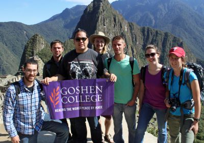 Rudy, Joshua, Jacob, Landon, Alan, Becca and Lauren unfurl a Goshen College banner at Machu Picchu.