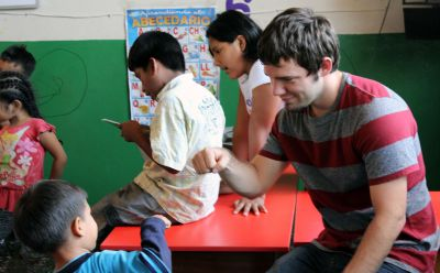 Affirmation: Joshua uses a fist bump to congratulate a child.