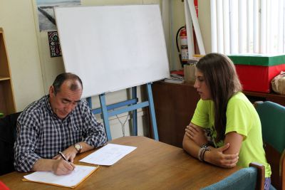 Lauren takes her oral examination with her Spanish teacher, Moises Arce Zavala.