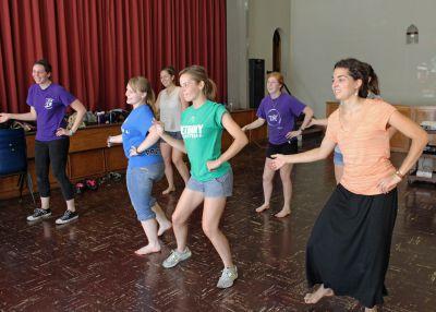 The women learn a new dance.