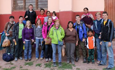Goshen College students gather with their host family members in Lucre, an Andean community near Cusco.
