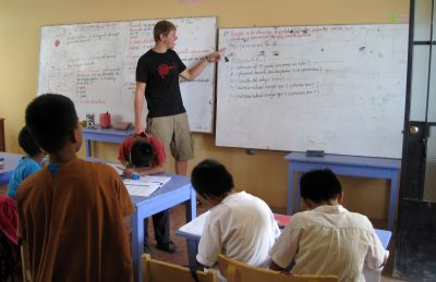 Dean in the classroom where he teaches English. This day class was not in session, but some of the children were there doing homework.