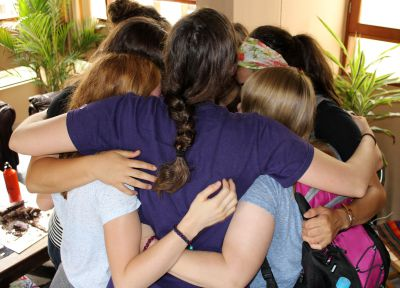 Goshen women say goodbye with a group hug.