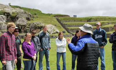 Students listen to Abrahan Quispe Corrales, our Cusco guide.
