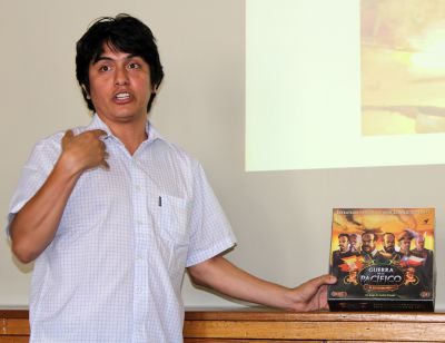 Andrés Francisco Paredes Salgado shows off Guerra en el Pacifico, a strategy board game he invented.