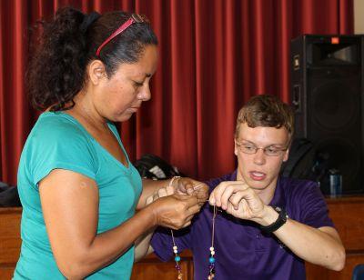 Eliana Mauriola Carrasco helps Thomas, her host son.