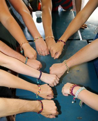 Students show off their new bracelets.