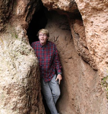 Jackson emerges from a cave.