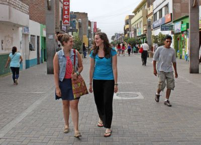 April and Malaina stroll down Calle Lopez de Zuñiga, a pedestrian-only street in Chancay.