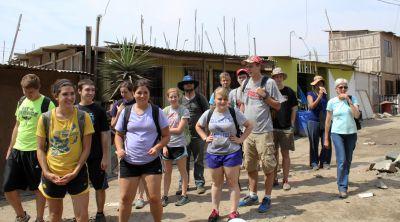 Students stroll through the community of Chavín de Huántar in Villa El Salvador.