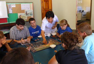 Andres provides guidance to students for playing Guerra en el Pacifico.