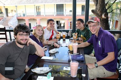 Jonathan, Aimee, Jake, Gretchen and Thomas enjoy drinks and dessert in an Ayacucho cafe and restaurant.