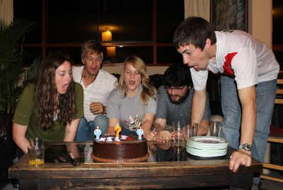 April, Derek, Aimee, Jonathan and Jake blow out the candles on their birthday cake.