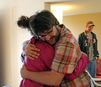Jonathan greets Malaina with a big hug.