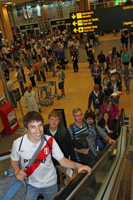 Jake, Dean, Jackson, Jonathan, April and other students head toward their departure gate at the Lima airport.