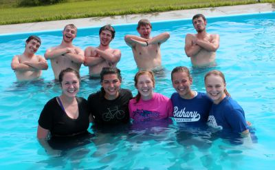 Goshen men and women strike decidedly different poses in the pool.