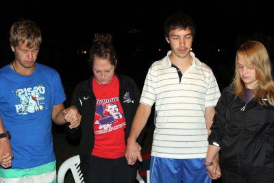 Derek, Malaina, Jake and Aimee join the prayer circle.