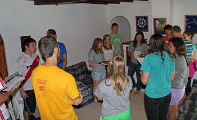 Students sing a hymn during the Sunday worship service.
