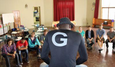 Camilo Ballumbrosio shows students how to play the cajón.