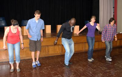 Camilo Ballumbrosio teaches Jaime, Derek, Leah and Lucas how to tap dance.