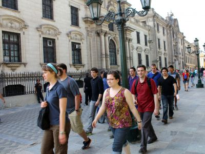 Students stride past the Government Palace.